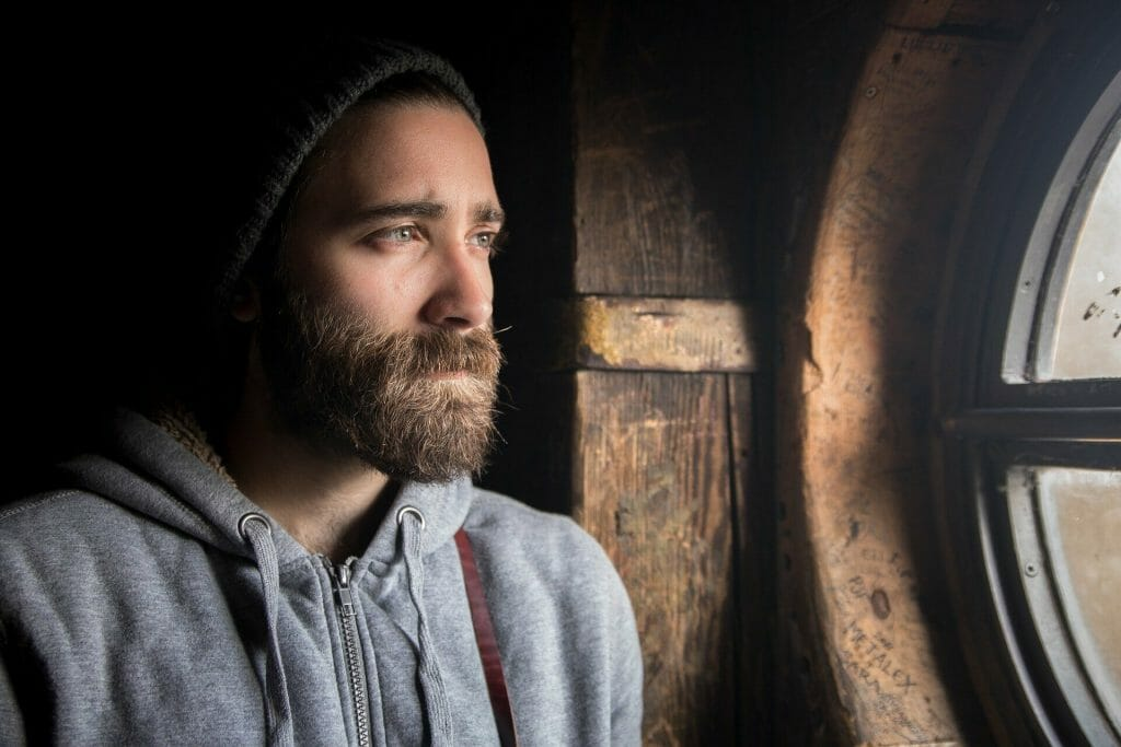 Living With Regret How to Get Over Regret man looking out window