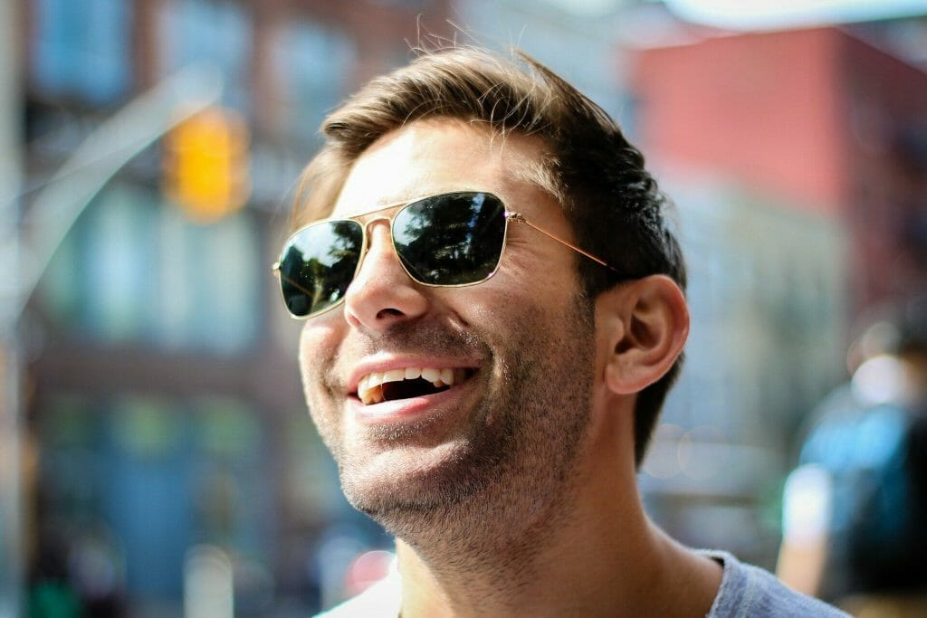 Man with sunglasses on smiling
